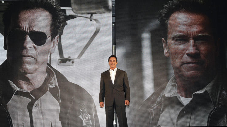 "Actor Arnold Schwarzenegger poses during a press conference to promote his latest film ""The Last Stand"" in Seoul, South Korea, Wednesday, Feb. 20, 2013. The movie will open on Thursday, Feb. 21, in South Korea.  (AP Photo Ahn Young-joon)"