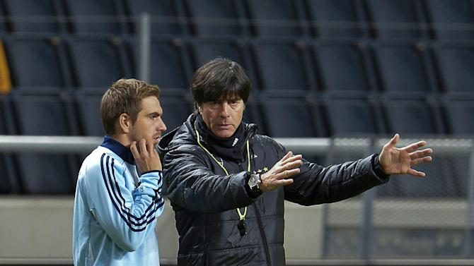 Germany's soccer coach Joachim Loew, right, and captain Philipp Lahm attend a training session at Friends Arena in Stockholm, Sweden, Monday Oct. 14, 2013. Germany will play Sweden in their World Cup qualifier match on Tuesday