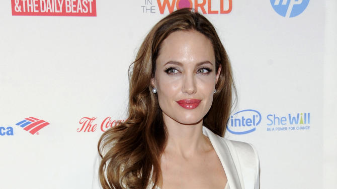 FILE - This March 8, 2012 file photo shows actress Angelina Jolie at the Women in the World Summit  in New York. Jolie authored an op-ed for Tuesday's May 14, 2013 New York Times where she writes that in April she finished three months of surgical procedures to remove both breasts as a preventive measure. She says she's kept the process private but is writing about it now with hopes she can help other women. (AP Photo/Evan Agostini, file)