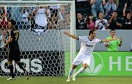 Real Madrid's Gonzalo Higuain (right) celebrates his opening goal against the LA Galaxy during first half action in the World Football Challenge friendly match in Carson, California. Real Madrid opened their four-game tour of the US by routing Major League Soccer champions Los Angeles Galaxy 5-1 in an exhibition match at the Home Depot Center stadium
