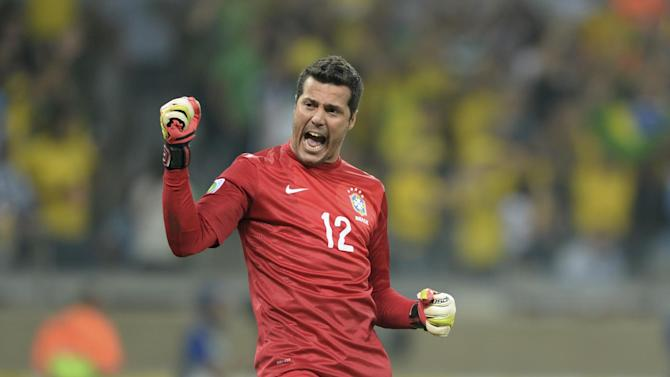 In this June 26, 2013 file photo, Brazil's Julio Cesar celebrates his team's 2-1 victory at a Confederations Cup semifinal soccer match with Uruguay in Belo Horizonte, Brazil. Cesar is the weakest link in the national team which all of Brazil expects to win the 2014 World Cup. That is no accident: Brazil has long paid far more attention to players who score and make goals than to those who save them