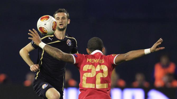 Dinamo Zagreb's Marcelo Brozovic challenges PSV Eindhoven's Memphis Depay during their Europa League match at Maksimir stadium in Zagreb