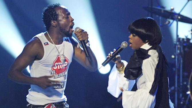 "FILE - This June 28, 2005 file photo shows Wyclef Jean, left, and Lauryn Hill performing during the 5th annual BET Awards in Los Angeles. Jean has written an autobiography, ""Purpose,"" on sale Tuesday, Sept. 18, 2012. (AP Photo/Chris Pizzello, file)"