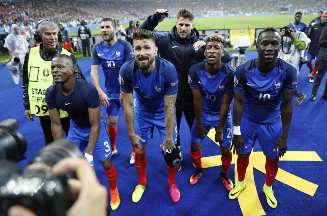 France's Patrice Evra, Olivier Giroud, Kingsley Coman and Bacary Sagna celebrate after the game