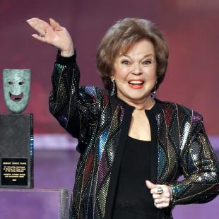 FILE - In this Jan. 29, 2006 file photo, Shirley Temple Black accepts the Screen Actors Guild Awards life achievement award at the 12th Annual Screen Actors Guild Awards, in Los Angeles. Costumes, toys, photos and autographs from Temple's 1930s film career are coming to a city near you. A spokeswoman for the late actress said Monday, March 30, 2015, that a collection of keepsakes from Temple's time in Hollywood will be exhibited at museums across the country before being put up for auction in July. (AP Photo/Mark J. Terrill, File)