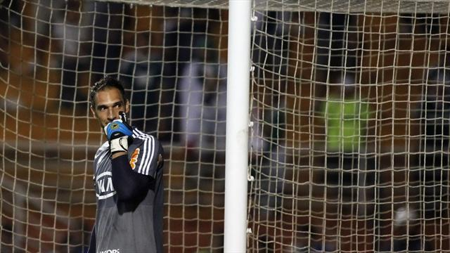South American Football - Palmeiras goalkeeper hurt by own fans