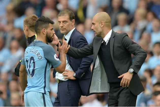 Manchester City's manager Pep Guardiola (R) greets striker Sergio Aguero after he was substituted on August 28, 2016