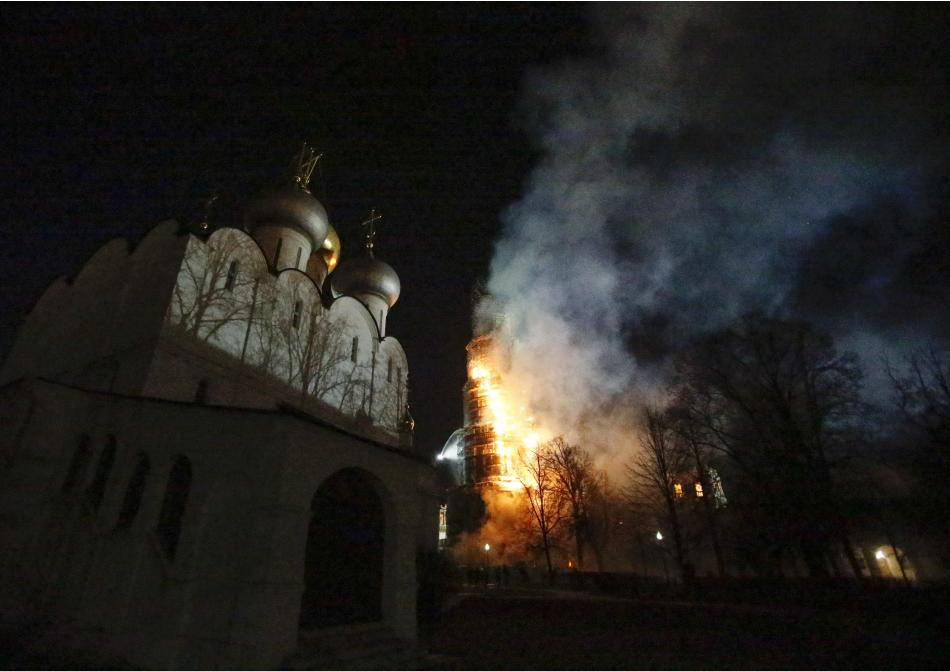 The bell tower of Novodevichy monastery burns as it is engulfed in flames in Moscow