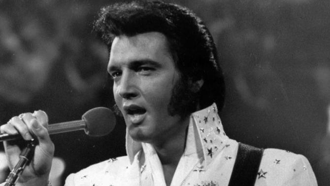 FILE - In this undated file photo released by NBC-TV, singer Elvis Presley is shown in concert in the later part of his career.  On June 6, 2012, Digital Domain Media Group announced it was creating a hologram Presley for shows, film, TV, and other projects worldwide, including appearances. Permission was granted from Elvis Presley Enterprises.(AP Photo/NBC-TV, FILE)