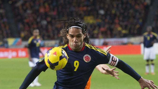 Colombia's Falcao fights for the ball with the Netherlands' Blind during their international friendly soccer match in Amsterdam
