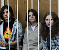 "Members of the all-girl punk band ""Pussy Riot"" Nadezhda Tolokonnikova (left), Yekaterina Samutsevich (centre) and Maria Alyokhina sit behind bars during a court hearing in Moscow on July 23. Members of the all women punk group 'Pussy Riot' who allegedly stormed a Moscow church to sing an anti-Putin song face up to seven years in a prison colony after being charged with hooliganism"