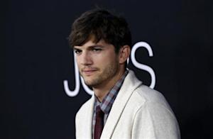 "Ashton Kutcher poses at the premiere of ""Jobs"" in Los Angeles"