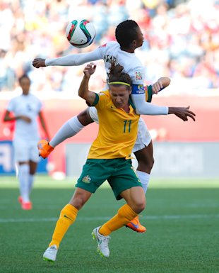 WINNIPEG, MB - JUNE 12:  Lisa De Vanna #11 of Australia challenges Evelyn Nwabuoku #14 of Nigeria for a header during the FIFA Women's World Cup Canada 2015 match between Australia and Nigeria at Winnipeg Stadium on June 12, 2015 in Winnipeg, Canada.  (Photo by Kevin C. Cox/Getty Images)