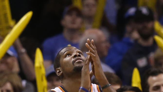Oklahoma City Thunder forward Kevin Durant (35) claps his hands as he looks up at the scoreboard as the game clock winds down in the fourth quarter of an NBA basketball game against the Sacramento Kings in Oklahoma City, Sunday, Jan. 19, 2014. Oklahoma City won 108-93