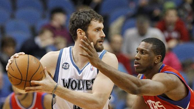 Minnesota Timberwolves forward Kevin Love, left,  looks to drive against Philadelphia 76ers forward Thaddeus Young, right, during the first quarter of an NBA basketball game in Minneapolis, Wednesday, Dec. 11, 2013