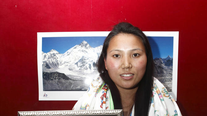Nepalese woman mountaineer Chhurim who has been recognized by Guinness World Records for climbing Mount Everest twice in the same climbing season poses with the certificate issued to her in Katmandu, Nepal, Monday, Feb. 25, 2013. 29-year-old Chhurim scaled the 8,850-meter (29,035-foot) summit on May 12, 2012, and again a week later on May 19. (AP Photo)