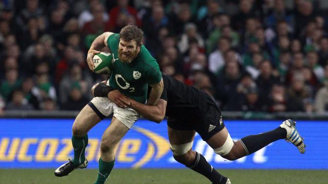 New Zealand's Luatua challenges Ireland's D'Arcy in their International rugby union match in Dublin