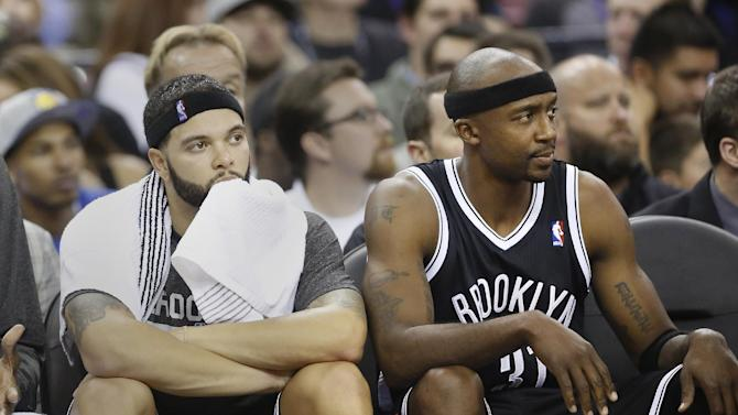 Brooklyn Nets' Deron Williams, left, and Jason Terry watch the action from bench action during the fourth quarter of their 107-86 loss to the Sacramento Kings in a NBA basketball game in Sacramento, Calif., Wednesday, Nov. 13, 2013