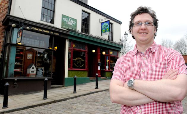Simon Crompton infront of the best pub in Britain, the Baum, Rochdale (PA)