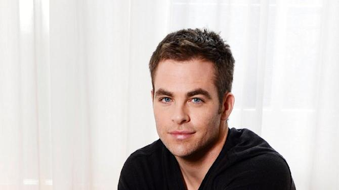 """This Wednesday Sept. 19, 2012 photo shows Chris Pine posing for a portrait session at Claridges, in London. As a kid, Chris Pine used to be afraid of the bogeyman. Now he fights one on the big screen.  The 32-year-old American actor is taking on his first voice-over role as Jack Frost in Dreamworks animated film """"Rise of the Guardians."""" His winter wonderland character is asked to join Santa, the Easter Bunny and the Tooth Fairy _ played by Alec Baldwin, Hugh Jackman and Isla Fisher _ to defeat a bogeyman called Pitch (Jude Law). Pine says the most magical part is getting to see his vocals combined with the animators' work.   (Photo by Jon Furniss/Invision/AP)"""