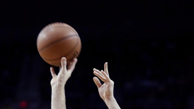 Dallas Mavericks forward Dirk Nowitzki shoots a three point shot during the first half of an NBA basketball game against the Portland Trail Blazers in Portland, Ore., Saturday, Dec. 7, 2013