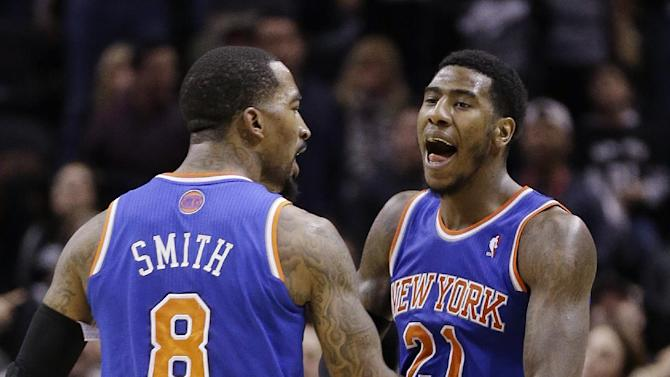 New York Knicks' Iman Shumpert (21) celebrates with teammate J.R. Smith (8) after he scored against the San Antonio Spurs during the second half on an NBA basketball game, Thursday, Jan. 2, 2014, in San Antonio. New York won 105-101