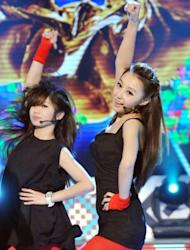 "Chinese native Qi Ji (R) performs during a new talent show ""Asian Idol Group Competition,"" in Taipei, in May. Growing numbers of young Chinese performers are eschewing the entertainment scene at home and instead coming to Taiwan in the hope of getting a big break. But can an Asian star break out beyond regional success?"