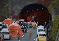 Japan rescue workers and police gather outside the Sasago tunnel along the Chuo highway near Otsuki in Yamanashi prefecture after part of the tunnel collapsed. Japanese rescuers found several charred bodies in the highway tunnel that collapsed early in the day, crushing cars and triggering a blaze, and sparking fears of another cave-in