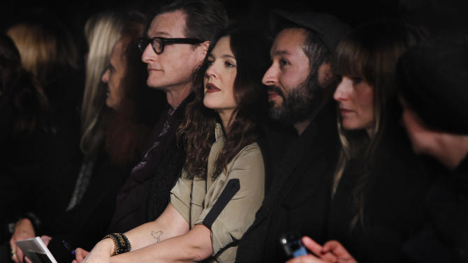 Actress Drew Barrymore (C) watches a presentation of the Rag & Bone Autumn/Winter 2013 collection during New York Fashion Week