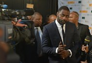 "British actor Idris Elba, who plays the role of Nelson Mandela in the movie ""Mandela, Long Walk to Freedom"", arrives for the movie's premiere in Johannesburg on November 3, 2013"