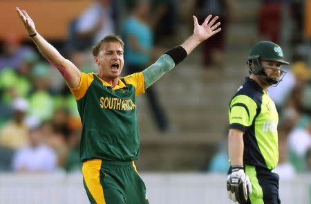 South Africa's Dale Steyne reacts after dismissing Ireland's Paul Stirling for nine runs during their Cricket World Cup match at Manuka Oval in Canberra