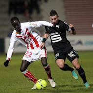 Ajaccio's defender Fousseni Diawara (L) fights for the ball with Rennes' forward Mevlut Erding during their French L1 football match at the Francois Coty stadium in Ajaccio, on the French mediterranean island of Corsica, on December 22, 2012. Rennes are fourth after a 4-2 win at Ajaccio