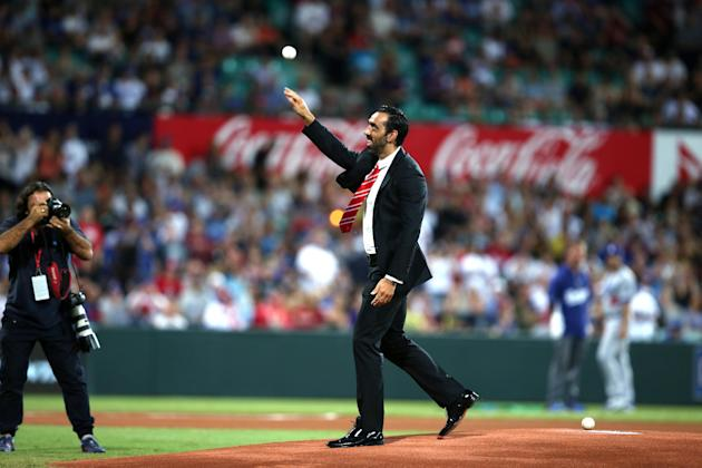FILE - In this March 22, 2014 file photo, Australian of the year AFL player Adam Goodes throws out the ceremonial first pitch before the Major League Baseball opening game between the Los Angeles Dodg
