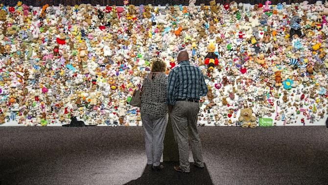 Mourners gather in front of a 'hedge of compassion' made of thousands of stuffed animals, prior to the commemoration ceremony for those who died in the crash of Malaysian Airlines flight MH17, in Nieuwegein on July 17, 2015