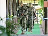 Fijian soldiers patrol near parliament in Suva in 2006. Fiji's military leader vowed to stick by his men on Friday, dismissing international concerns about an online video that appears to show two men being tortured by officials