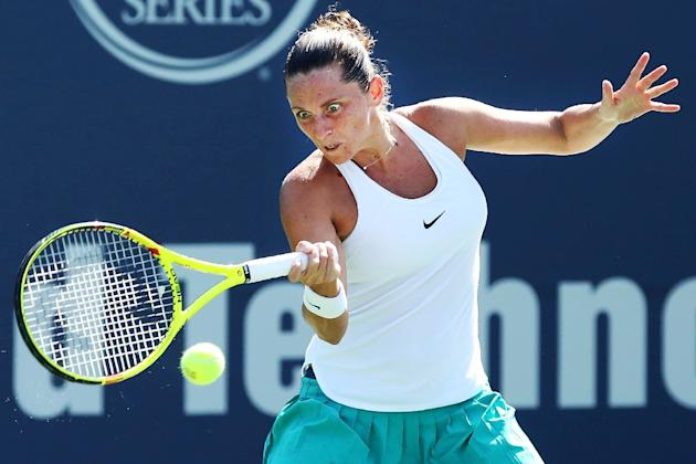 Roberta Vinci of Italy returns a shot during her match against Ana Konjuh of Croatia at the Connecticut Open