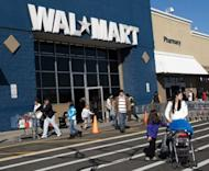 Customers outside a Walmart store in Connecticut, United States. International supermarkets had hoped India's market would open up but parliament adjourned in uproar Thursday amid little progress for the weakened government and its pro-market reform drive