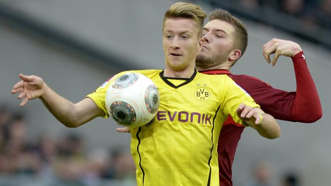 Hanover 96's Hoffmann and Borussia Dortmund's Reus fight for the ball during their German Bundesliga first division soccer match in Hanover