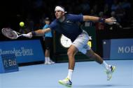 Juan Martin Del Potro of Argentina hits a return during his men's singles tennis match against Richard Gasquet of France at the ATP World Tour Finals at the O2 Arena in London November 4, 2013. REUTERS/Suzanne Plunkett
