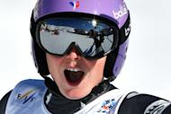 France's Tessa Worley celebrates after winning her fourth world ski title durin the giant slalom in St Moritz, on February 16, 2017
