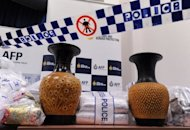 Australian Federal Police display ceramic vases used to conceal US$525 million worth of crystal methamphetamine and heroin after they smashed a Hong Kong-linked international drugs syndicate in Sydney on July 31. Four of those detained were from Hong Kong and the other three Australian residents