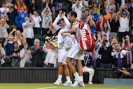 Spain's Rafael Nadal applauds as he leaves the court with Czech Republic's Lukas Rosol after Rosol won their second round men's singles match on day four of the 2012 Wimbledon Championships tennis tournament at the All England Tennis Club in Wimbledon, southwest London