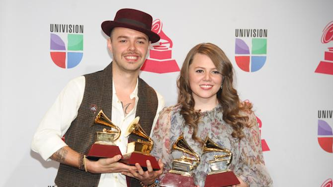 "Jesse & Joy pose backstage with the best contemporary pop vocal album award for ""Con Quien Se Queda el Perro"" and song of the year for ""Corre!"" at the 13th Annual Latin Grammy Awards at Mandalay Bay on Thursday, Nov. 15, 2012, in Las Vegas. (Photo by Brenton Ho/Powers Imagery/Invision/AP)"