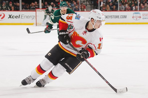 ST. PAUL, MN - APRIL 9: Johnny Gaudreau #13 of the Calgary Flames skates with the puck against the Minnesota Wild during the game on April 9, 2016 at the Xcel Energy Center in St. Paul, Minnesota. (Photo by Bruce Kluckhohn/NHLI via Getty Images)