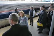 """Some of the 1,000 lobbyists, business owners and politicians gather on a platform at the Trenton train station as a train arrives to take them to Washington, D.C., Thursday, Feb. 16, 2017, in Trenton, N.J. The state Chamber of Commerce's 80th annual trip — nicknamed the """"Walk to Washington"""" because rail riders generally pace the train's corridors schmoozing and handing out business cards — comes after a national election that hinged in part on repudiating insiders and establishment politics. (AP Photo/Mel Evans)"""