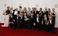 "The cast and crew from AMC's series ""Breaking Bad"" poses backstage with their awards for Outstanding Drama Series at the 65th Primetime Emmy Awards in Los Angeles September 22, 2013. REUTERS/Lucy Nicholson"