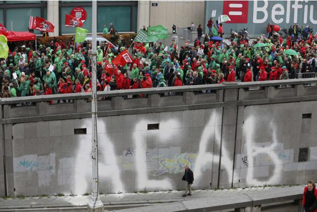 Trade union members march in central Brussels during a protest over the government's reforms and cost-cutting measures