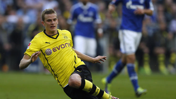 In this Oct. 26, 2014 file picture Dortmund's Sven Bender  plays the ball during the German first division Bundesliga soccer match between Schalke 04 and BvB Borussia Dortmund  in Gelsenkirchen, Germany. Borussia Dortmund midfielder Sven Bender has been ruled out for around 10 weeks with a groin injury. The Bundesliga club says the extent of the injury was revealed in an examination Sunday Feb. 23, 2014  by team doctor Markus Braun. Bender needs to avoid any sporting exertion for six weeks and Braun predicts a subsequent four-week recuperation period. Bender joins fellow midfielders Ilkay Gundogan and Jakub Blaszczykowski, as well as defender Neven Subotic, on the club's long-term injury list