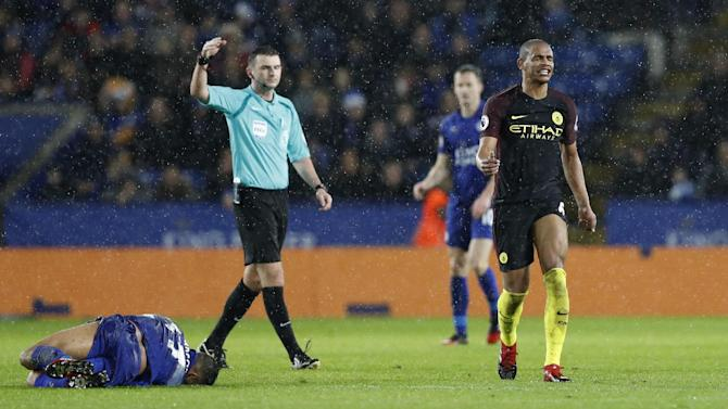 Manchester City's Fernando reacts after a foul on Leicester City's Danny Simpson