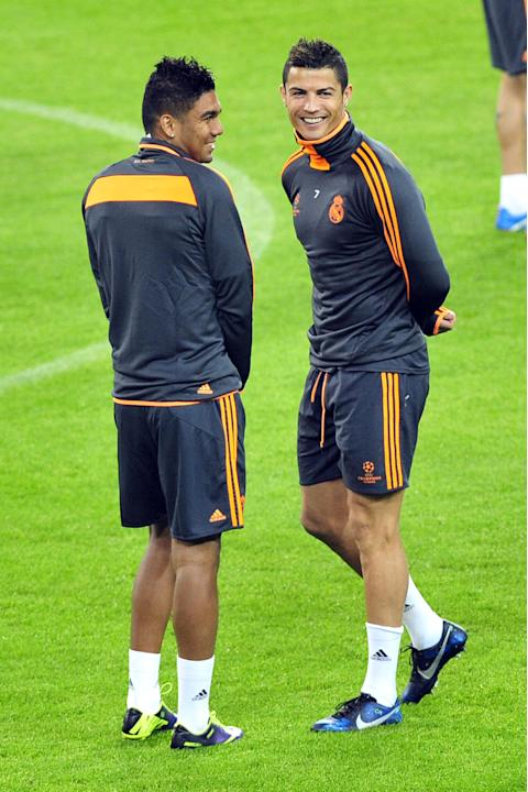 Real Madrid Cristiano Ronaldo, right, of Portugal, and Raphael Varane, of France, smile during a training session ahead of Tuesday's Champions League group B soccer match against Juventus, at the Juve